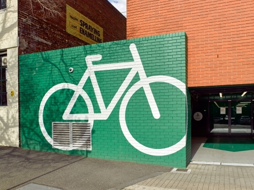 Bicycle graphic on wall in city