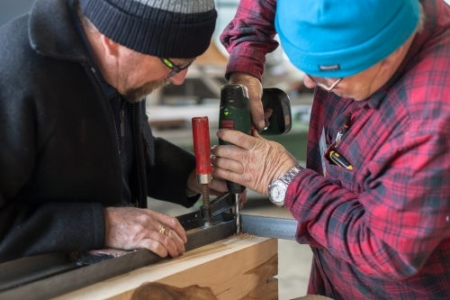 Men working together at a Men's Shed