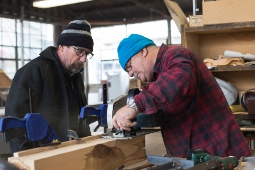 Men working on a project at a Men's Shed