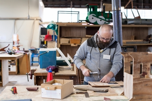 Man working on a project at a men's shed