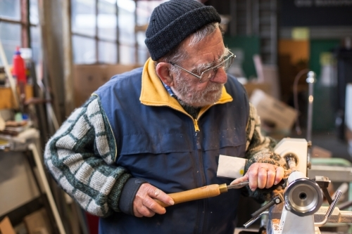 Man working with a lathe in a men's shed