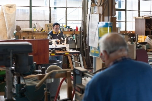 Men working at a men's shed