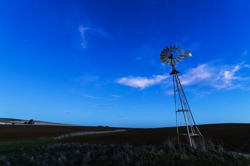 Windmill against a blue night sky