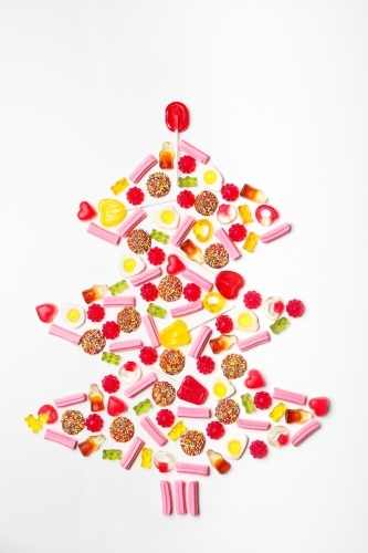 Christmas tree shape flat lay made from lollies and candy