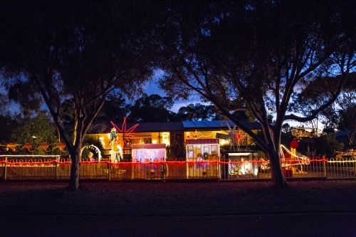 Christmas lights on country house