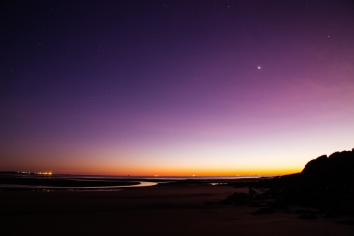 Purple dawn, early morning at low tide