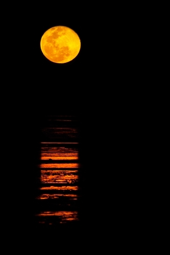 Ripples of light across water like a staircase to the moon