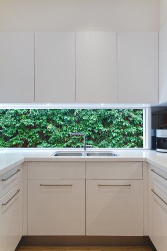Lowlife kitchen window outlook to formal garden greenery