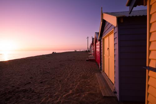 Sun setting on Brighton Bathing Boxes at Dendy Beach