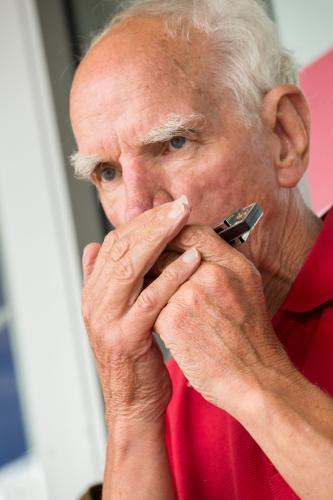 A man playing a harmonica