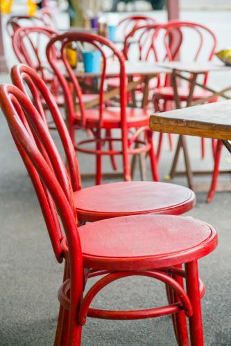 Red chairs outside a cafe