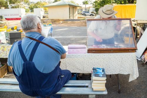 Two men buying and selling at a swap meet