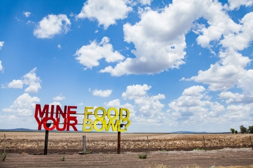 Mine your food bowl? sign on farm paddock fence