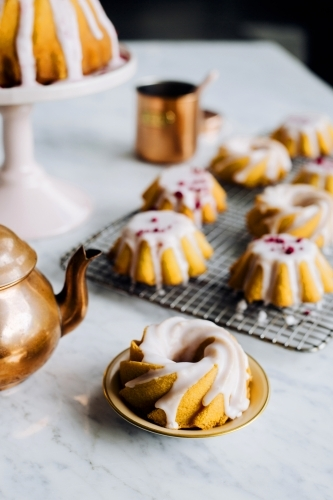 Mini iced bundt cakes on baking rack
