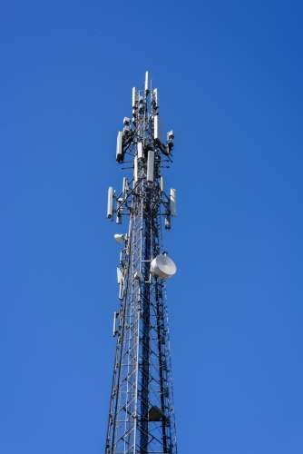 mobile phone communication repeater antenna. cell tower. on the blue sky background.