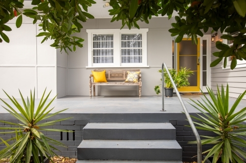 Modern Stylish Front Porch with Greenery