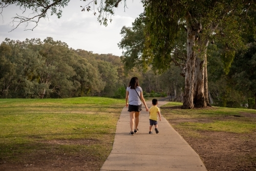 Mother and child walking together down a pathway in regional NSW