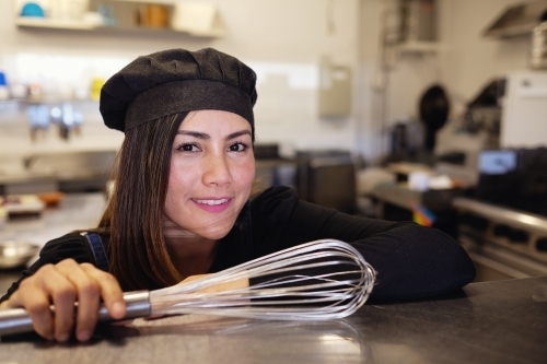 Multicultural Asian chef in small business restaurant
