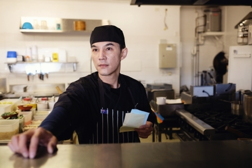 Multicultural Asian chef in Thai small business restaurant