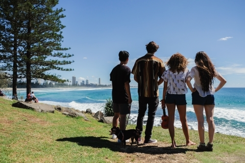 Multicultural teenagers hang out near the beach