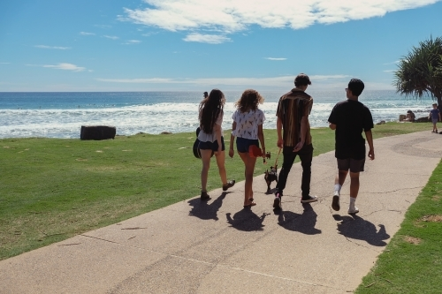 Multicultural teenagers walking near the beach