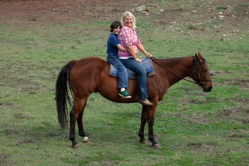Mum and son riding bareback together