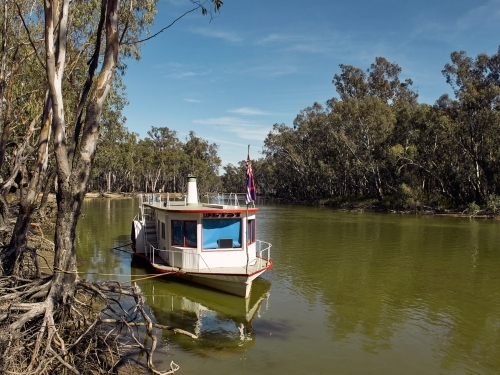 Paddle steamer on a river in the country