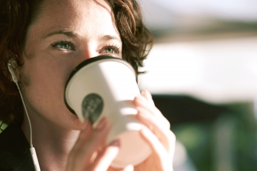 Lady drinking coffee in the morning
