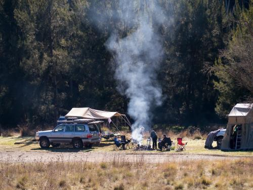 Family camping with fire, 4 wheel drive and tent