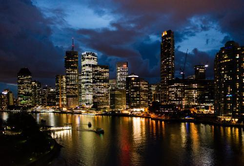 Night view of City skyline and lights reflected in the Brisbane River