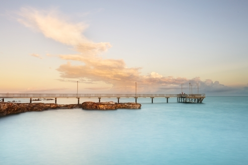 Nightcliff Jetty in morning light, pier with clouds in Darwin