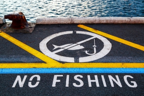 'No fishing' notification painted on a wharf