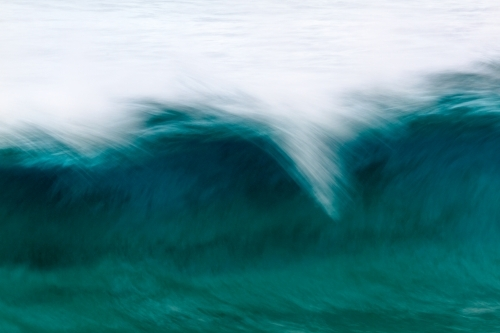 Motion blur abstract of a curling breaking wave at Norries Head, Cabarita Beach