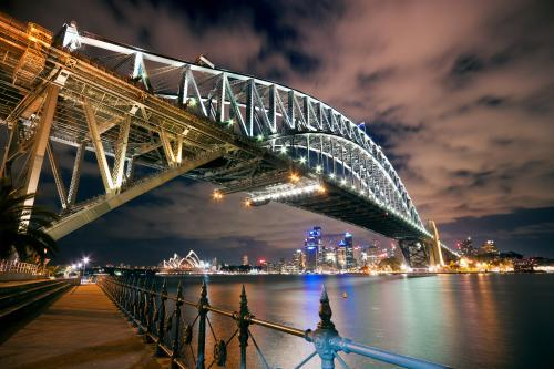 Looking up at the Sydney Harbour Bridge at night