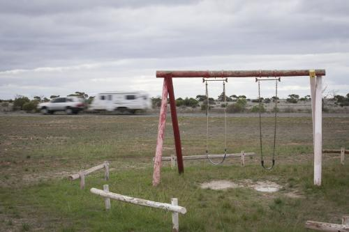 Old swings at a deserted playground on the Nullarbor