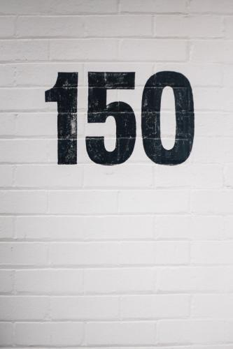 Number 150 Painted on Brick Wall