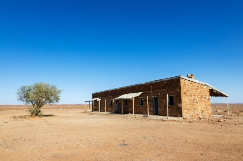 old building in desert landscape