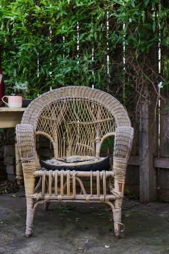 Old cane chair in the garden.
