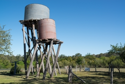 Old farm water tanks leaning