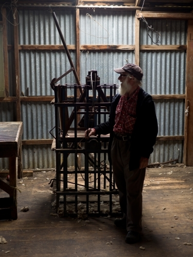 Old Man Contemplating in Shearing Shed