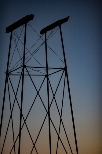 Old water tank stand at twilight