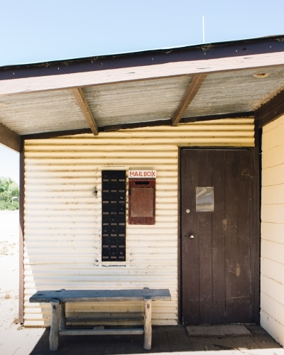 Old weatherboard post office building with mailbox