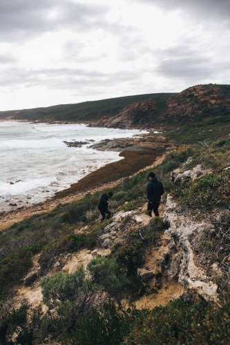 Overcast coastal landscape with two anonymous people