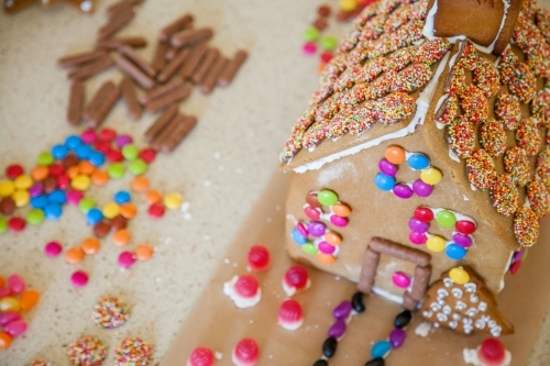 Overhead shot of gingerbread house and brightly coloured lollies