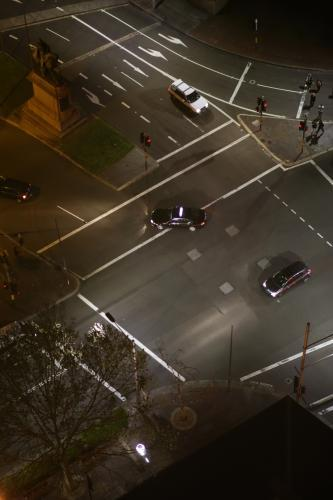 Overhead view of cars driving through an intersection in the city