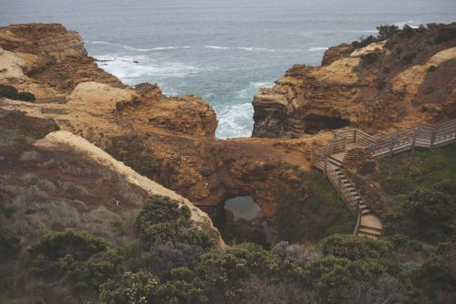 Overlooking cliffs and stairs of the Great Ocean Road landscape