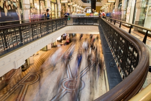 Overlooking commuters and shoppers blurred in motion at the Queen Victoria Building