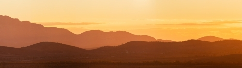 panorama of layered hills at sunset