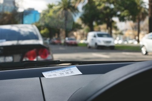 Parking ticket placed on car dashboard in Melbourne inner city