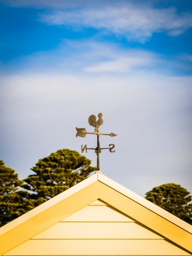 Weathervane on a gable roof.